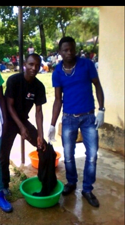 Am the one in blue t_shirt we were cleaning the environment